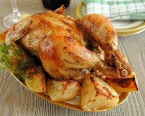 Цыпленок запеченный с картофелем  фото